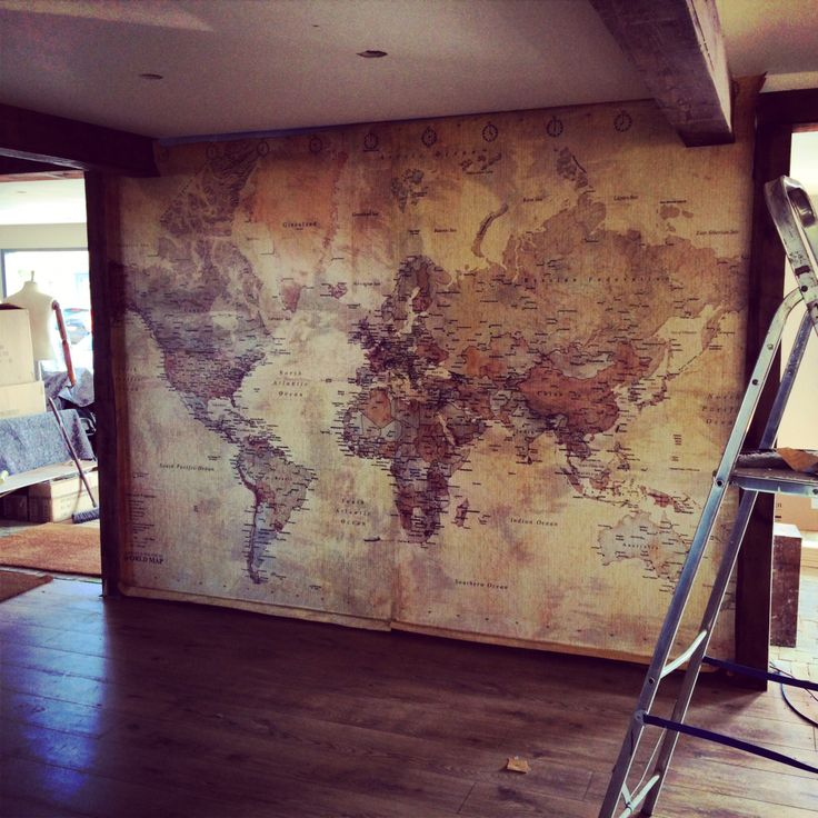 Hand painted historical maps are the new black for western for Antique world map wall mural